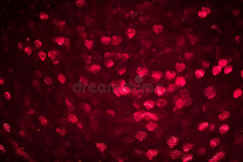 Abstract heart bokeh defocused red lights. Abstract heart bokeh defocused glitter red lights stock photo