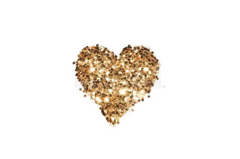 Abstract heart of golden glitter sparkles on white background. Abstract heart of golden glitter sparkles on white background for your design stock photo