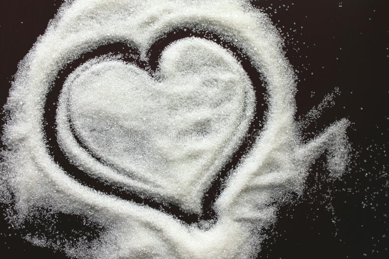Abstract heart from sugar grains. For a card on Valentine's Day stock images