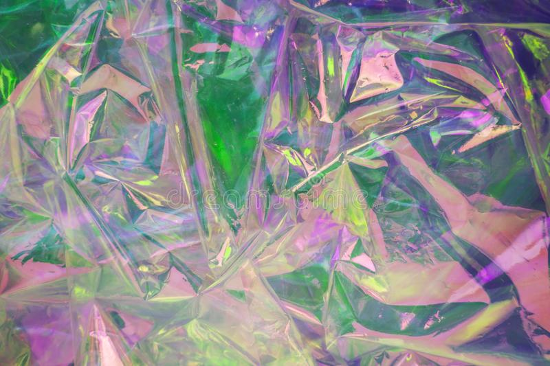 Abstract holographic background in the style of the 80s. Modern design for vaporwave. Neon colors. Iridescent hologram. Texture stock photos
