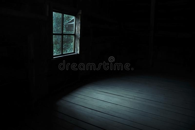 Abstract horror background for halloween. Gloomy scary terrible window with ghostly light and shadows in a dark black room in the stock photos