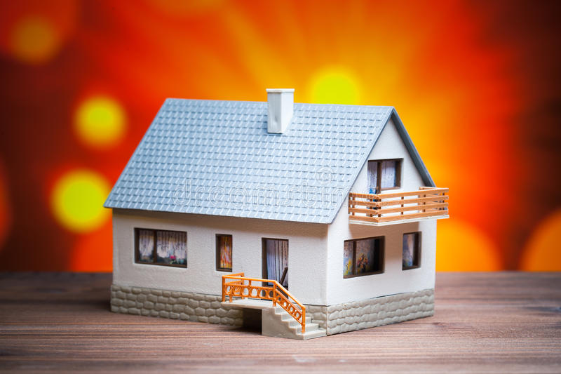 Abstract house. Against shiny orange color background stock photo