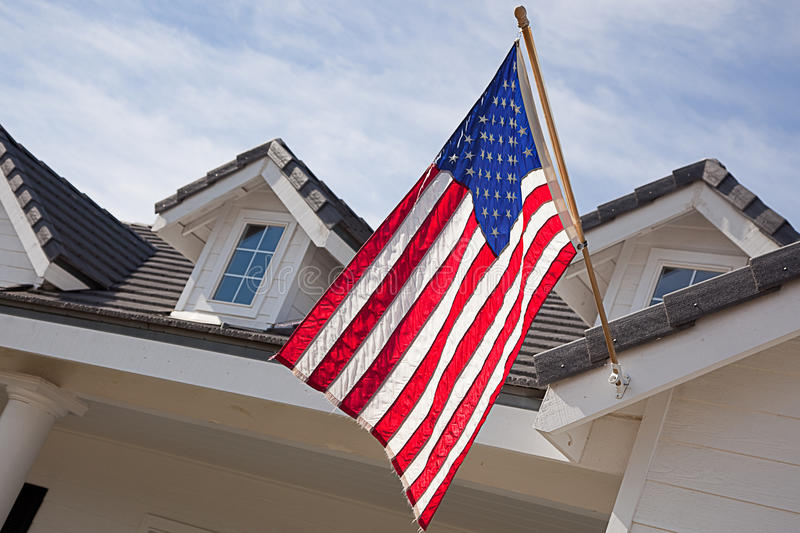 Abstract House Facade & American Flag. Against a Blue Sky royalty free stock images