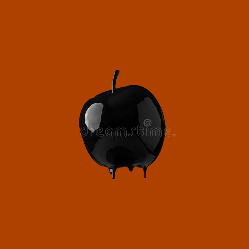 Black paint dripping on fruit. Abstract image of black paint dripping on fruit stock photography