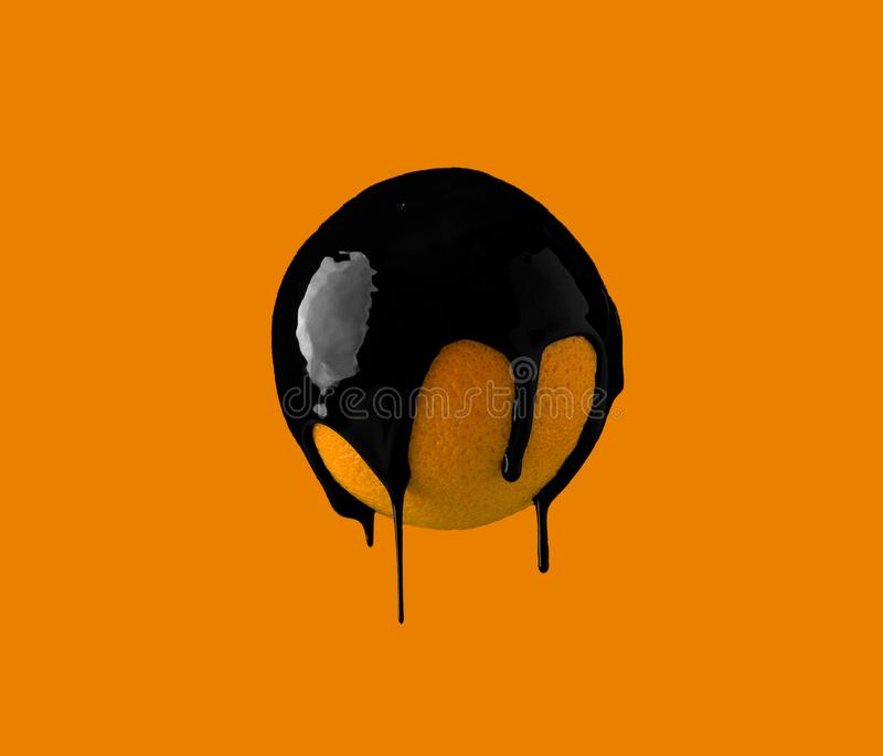 Black paint dripping on fruit. Abstract image of black paint dripping on fruit royalty free stock images