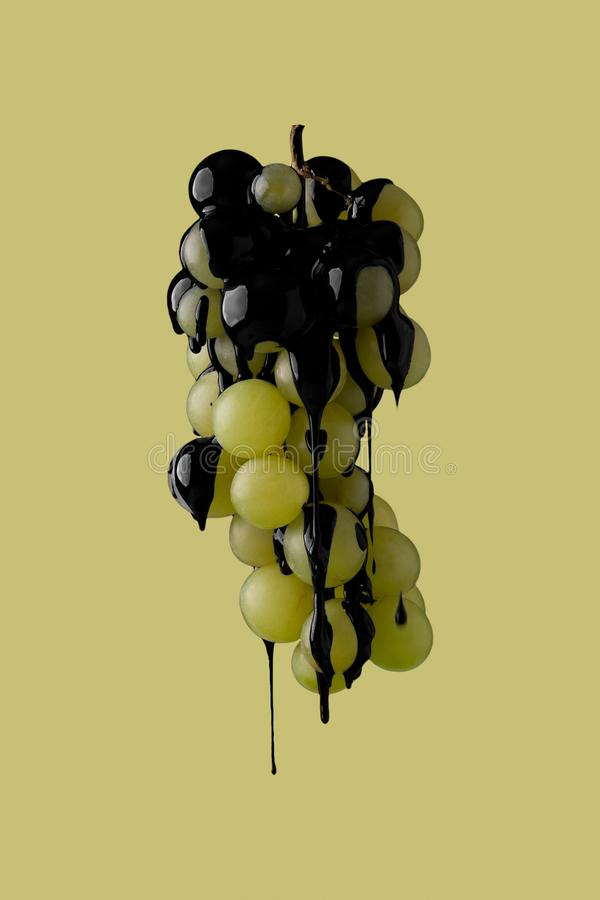 Black paint dripping on fruit. Abstract image of black paint dripping on fruit royalty free stock photography