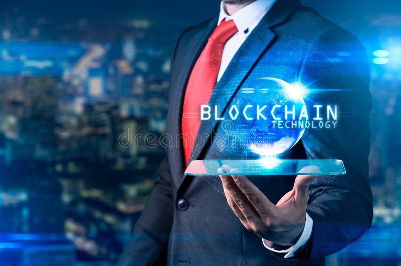 The abstract image of the business man hold the blockchain hologram on hand and element of this image furnished by Nasa. the conce stock photography