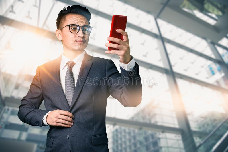 The abstract image of the businessman using a smartphone overlay with futuristic hologram. The concept of modern life, technology, stock photography
