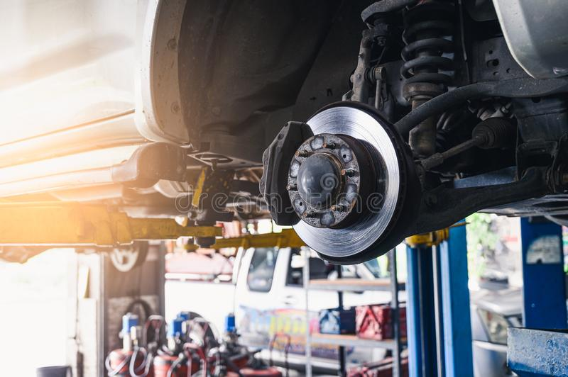 The abstract image of the cars brake disc installed on the vehicle. the concept of automotive, repairing, mechanical, vehicle and stock photography