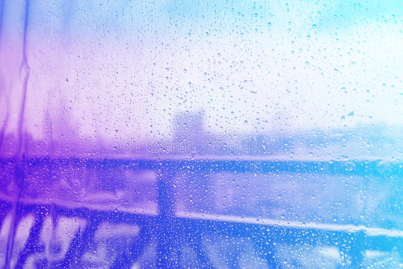 image of the city after the rain through the glass wallpaper stock images