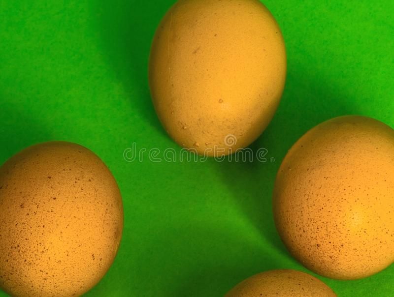 Abstract image of Easter, four incomplete eggs on a green background with soft shadows. Concept royalty free stock photos