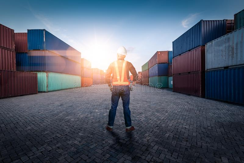 The abstract image of the engineer standing in shipping container yard and copy space. the concept of engineering, shipping, shipy royalty free stock photo