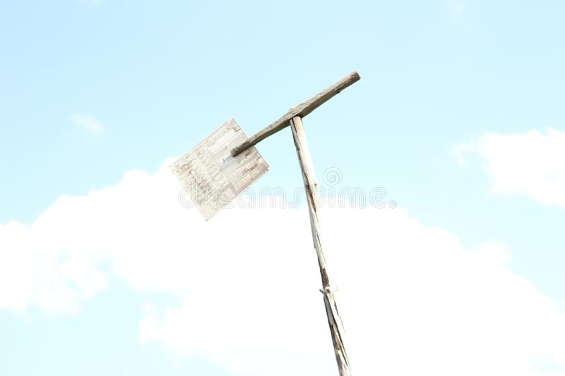 abstract image of an incomprehensible wooden object on the background of a blue sky stock photo