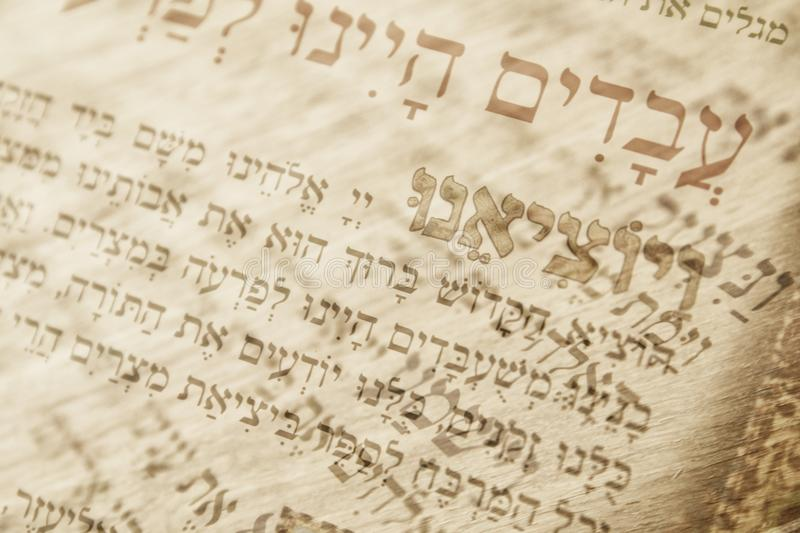 Abstract image of Judaism concept with closeup text in hebrew from the passover haggadah.  stock image