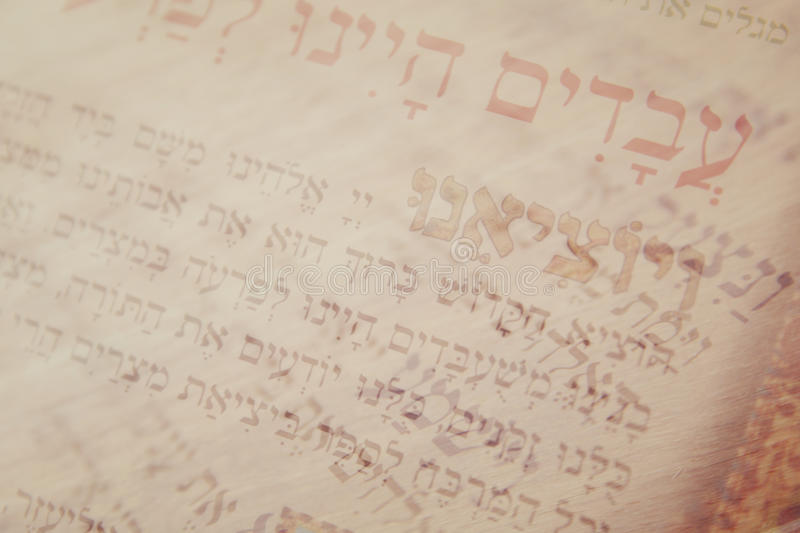 Abstract image of Judaism concept with closeup text in hebrew from the passover haggadah. Abstract image of Judaism concept with closeup text in hebrew from the royalty free stock photography