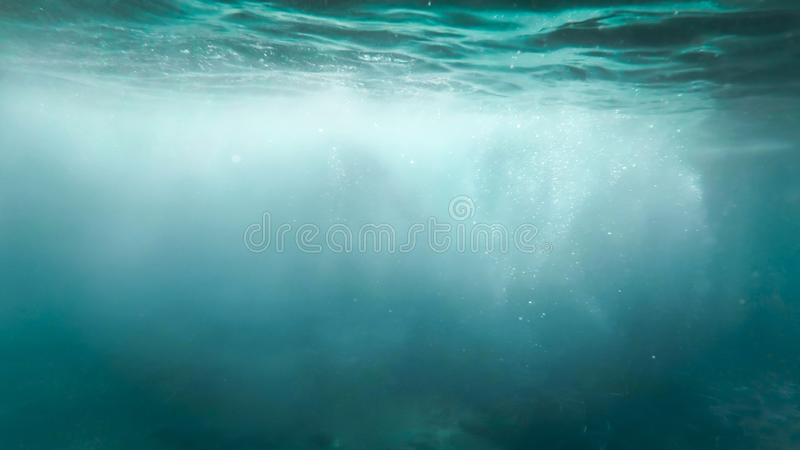 Abstract image of lots of bubbles floating in clear turqouise sesa water royalty free stock photos