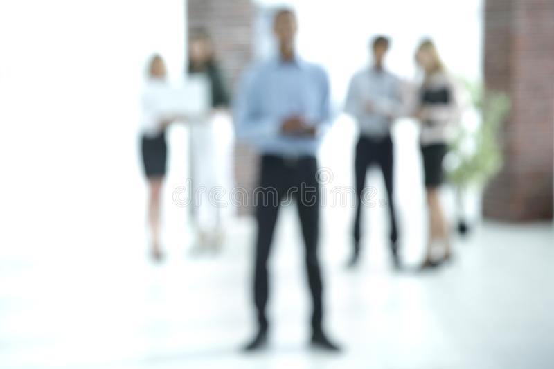 Abstract image of people in the lobby of a modern business center stock photography