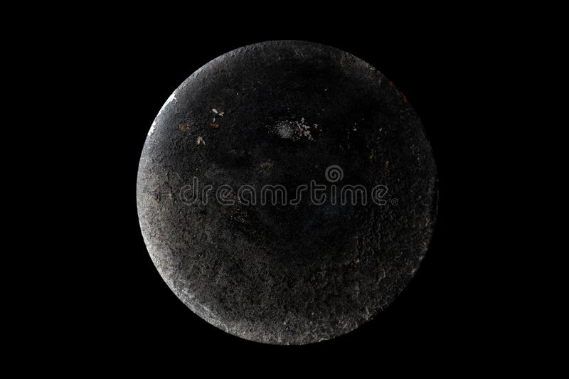 Abstract of planet Moon from the surface of an old griddle on a black background in space. Abstract image of planet Moon from the surface of an old griddle on a royalty free stock photo