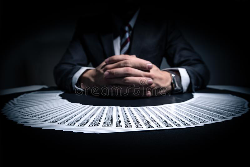 The abstract image of the play cards stack over front of the dealer. The concept of casino, gambling, poker, blackjack and cards royalty free stock photos