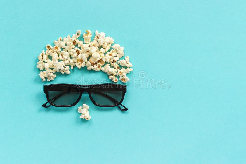 Abstract image of viewer, 3D glasses and popcorn on blue background. Concept cinema movie and entertainment Flat lay Top stock photos
