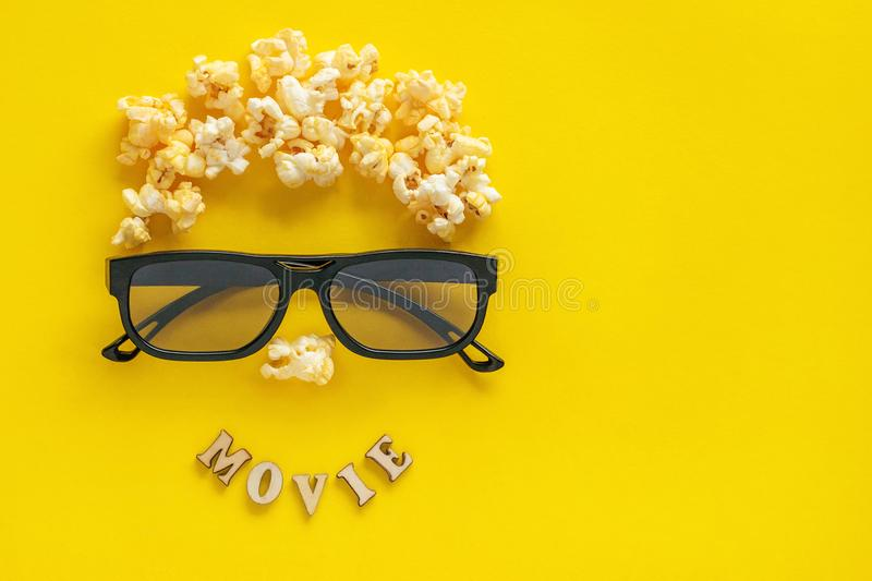 Abstract image of viewer, 3D glasses and popcorn, text stock photo