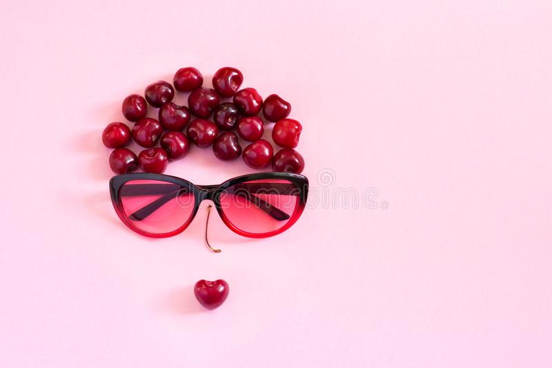 abstract image young woman from sweet cherry and glasses. Concept stock photo