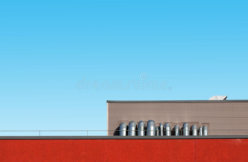 Abstract industrial architecture. Abstract architecture picture with industrial building detail against blue sky royalty free stock photos