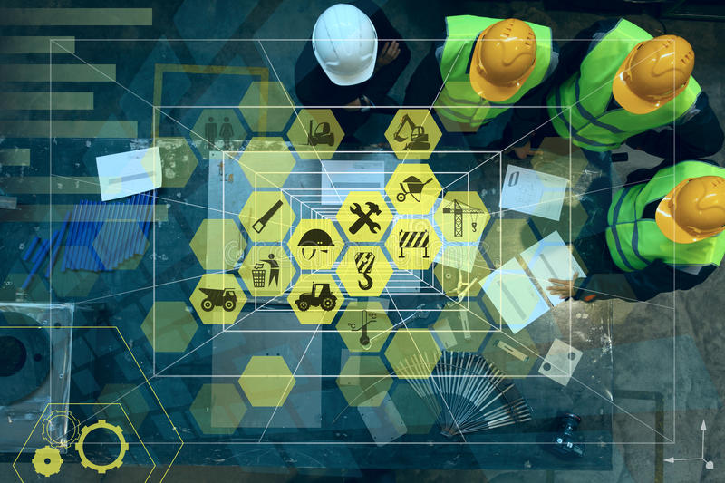 Abstract industry concept. Workers at factory and conceptual graphic design with manufacturing icons stock photography