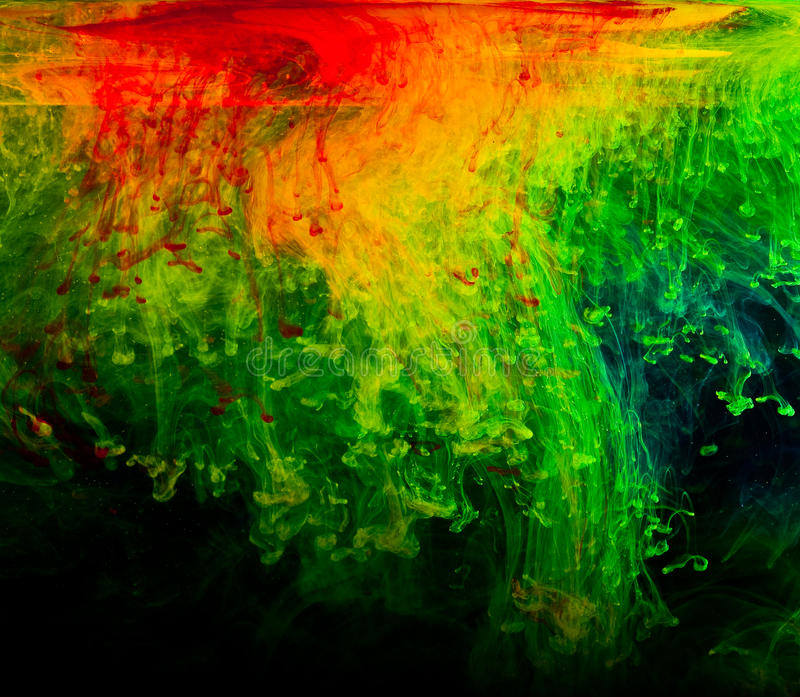 Abstract ink in water. Abstract drawing formed by paint dissolving in clear water stock photos