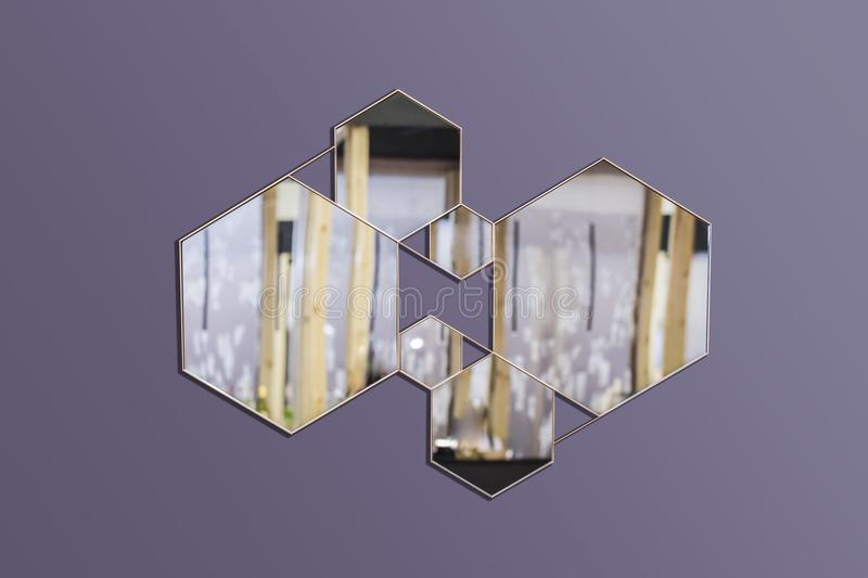 Abstract interior with geometric mirrors on an isolated background. Hexagonal mirrors, fashionable composition in the interior royalty free stock photos