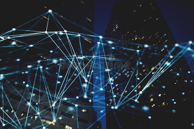 Abstract internet connection network with night city with skyscrapers at the background. Futuristic abstract internet connection network with night city with stock image