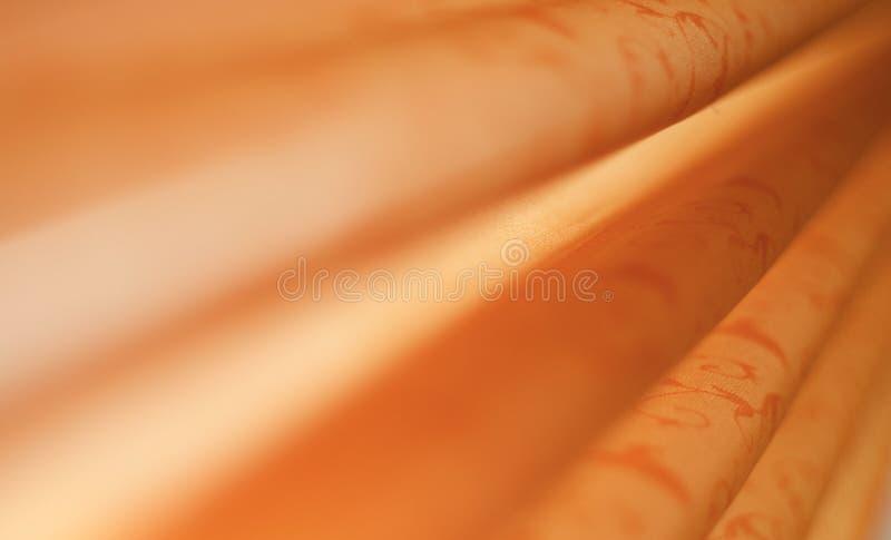 Abstract kijk van zachte sinaasappel gevouwen damaststof stock fotografie