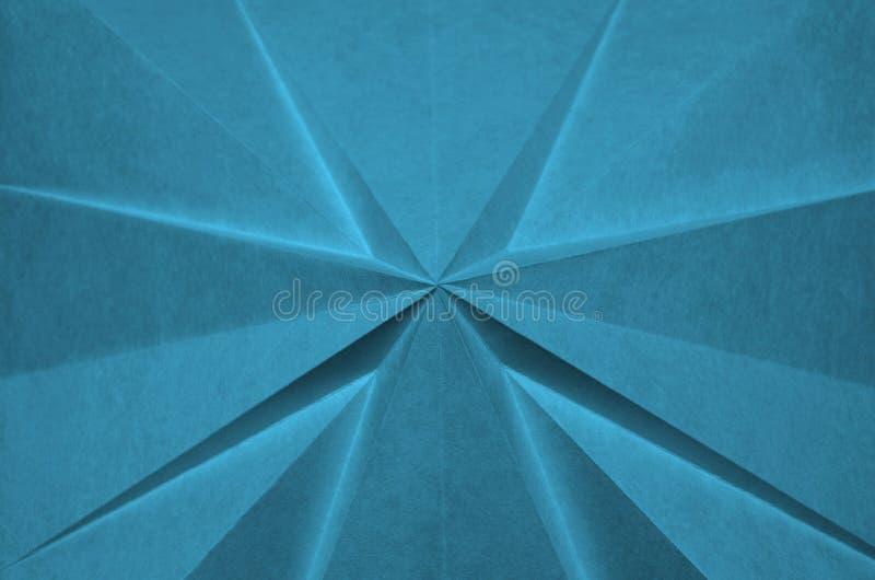 Abstract kruis van blauwe origami stock foto