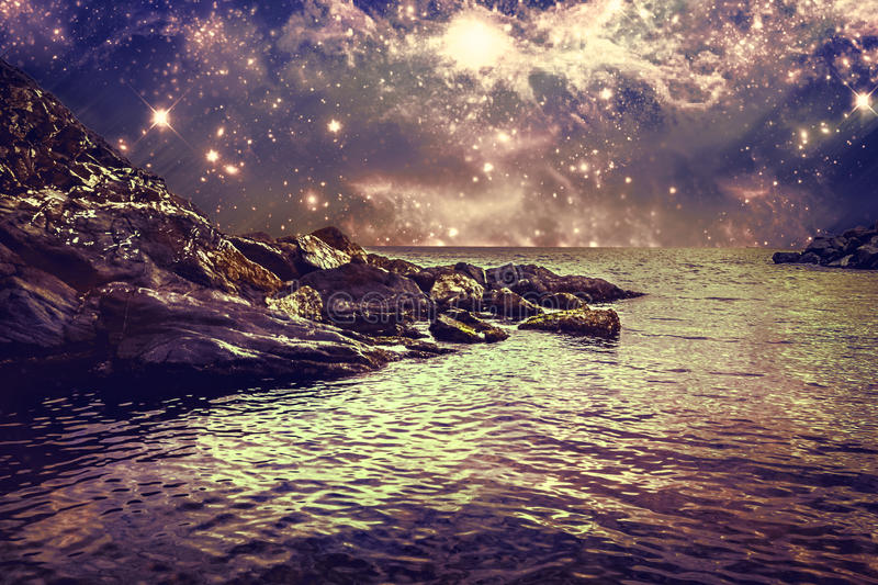 Abstract landscape with rocky coast, sea and sky. Abstract night scape with constellations on the sky royalty free stock photos