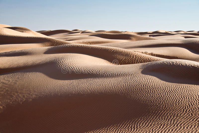 Abstract landscape in the Sand dunes desert of Sahara. South Tunisia royalty free stock photography