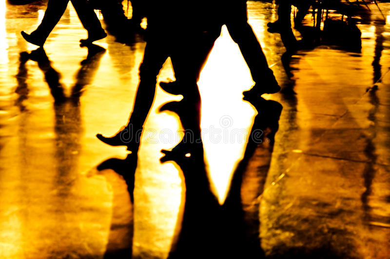 Abstract legs and shadows. Abstract, creative, digitally altered and toned photo of people legs and their shadows royalty free stock photography