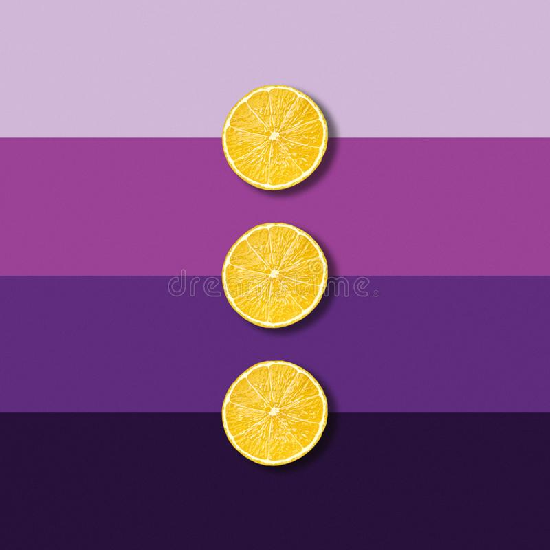 Abstract lemon slices on electric purple background stock photo
