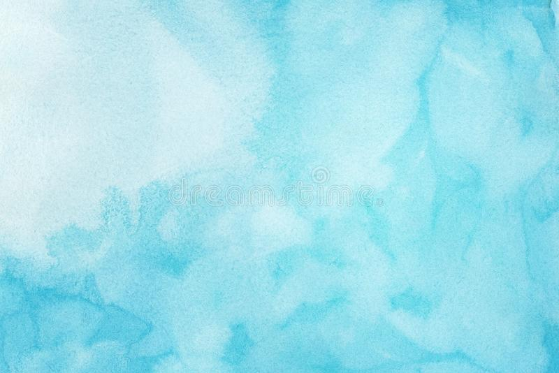 Abstract light blue watercolor background, painted on watercolor paper. Abstract light blue watercolor splashes background, painted on watercolor paper stock images
