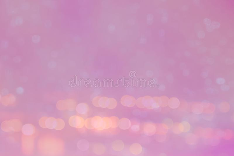 Abstract light bokeh on the pink glowing background stock image