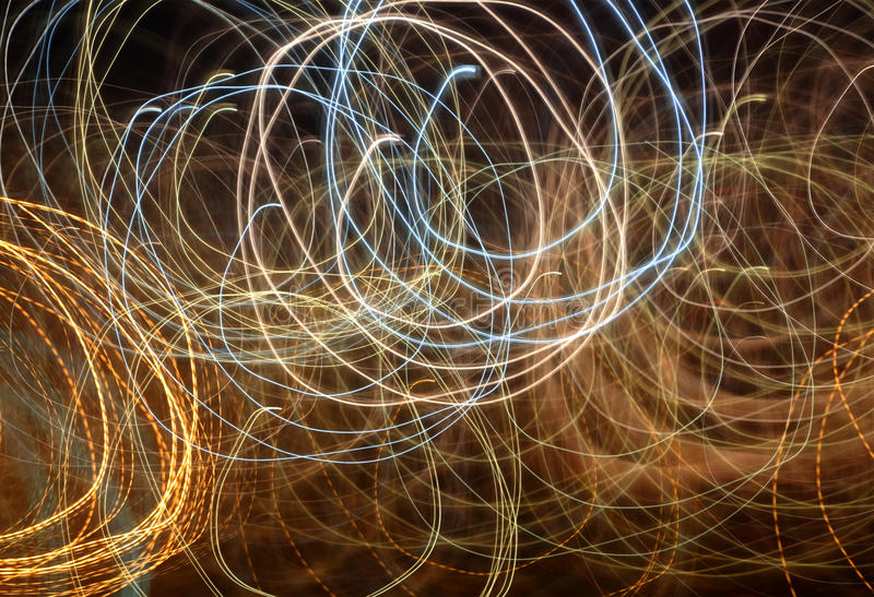 Abstract light lines. On black background royalty free stock image