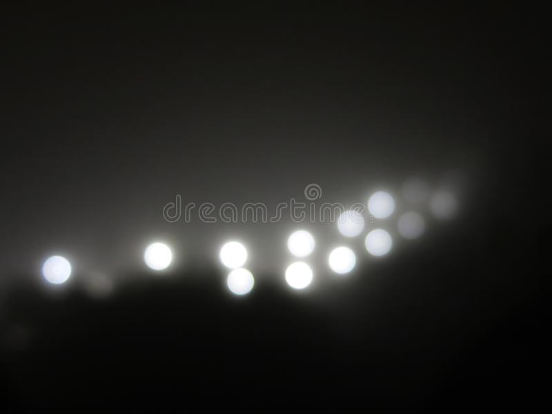 Abstract lights in the fog. Ray of bright white light royalty free stock photography