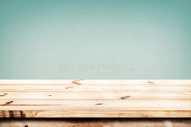 Abstract lights gradient blurred background. Empty wood table ready for your product display montage. Abstract lights gradient blurred background royalty free stock photo