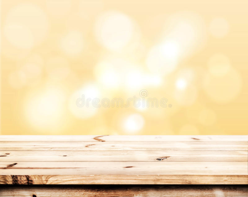 Abstract lights gray and gold bokeh blurred background. Empty wood table ready for your product display montage. Abstract lights gray and gold bokeh blurred royalty free stock images