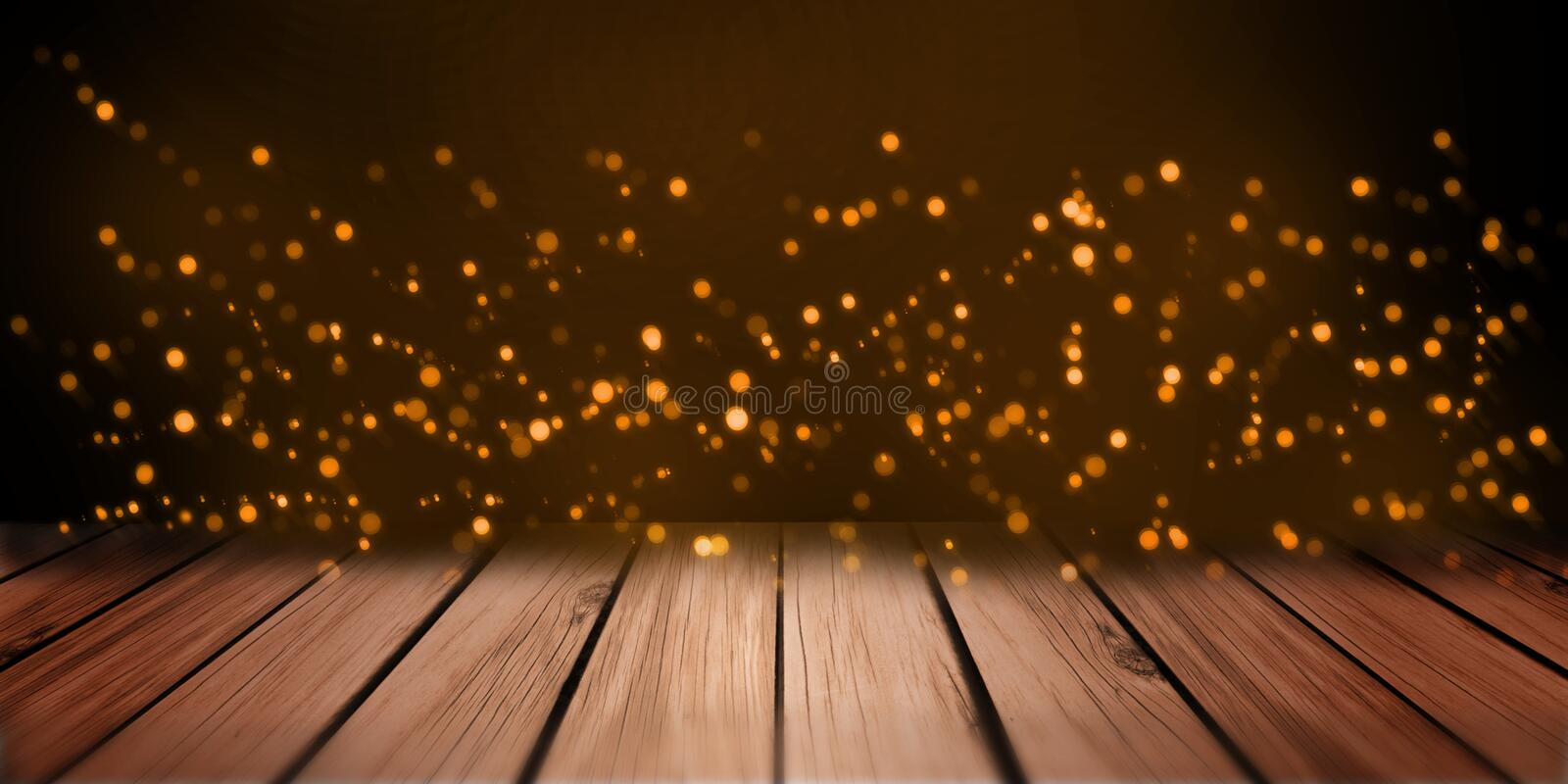 Abstract lights orange bokeh on wood plate shelf table perspective. royalty free stock photos
