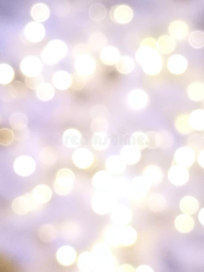 Abstract lights purple, violet and white light bokeh background for Xmas, Valentine, New Year, Easter or special event and moment royalty free stock images