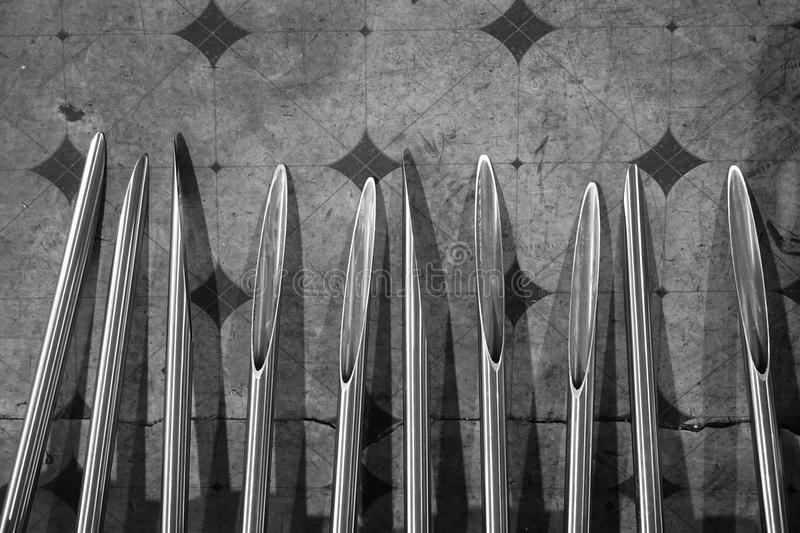 Metal injection needle. Abstract line up of metal injection needle in black and white tone stock image
