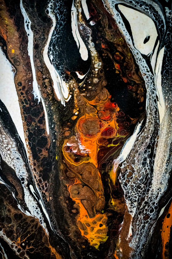 Abstract liquid painting with cells. Black, orange and white stock photo