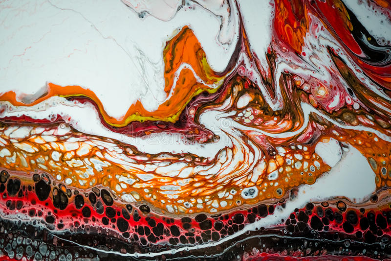 Abstract liquid painting with cells. Black, orange and white stock photography