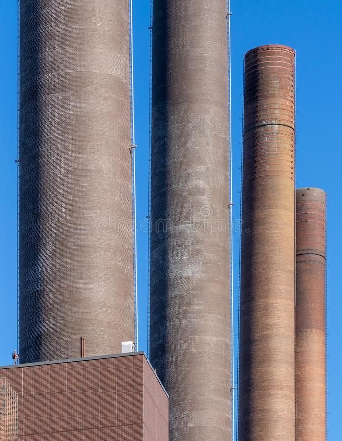 Abstract looking chimneys of the power plant of a large factory stock images