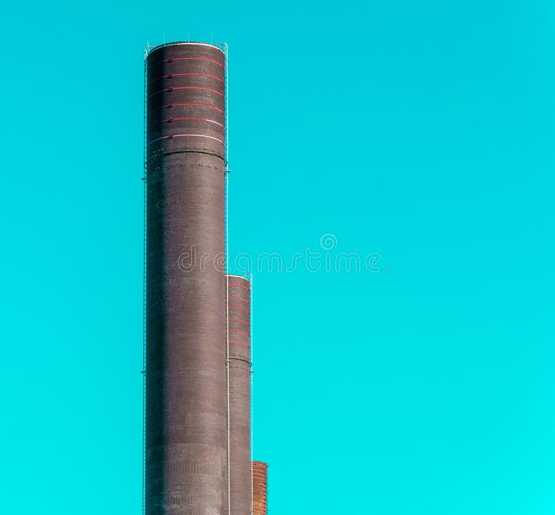 Abstract looking chimneys of the power plant of a large factory royalty free stock photo